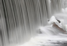 Smooth Cascade. Soft curtain of water crashing on to rocks royalty free stock images