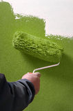 Smooth concrete wall hand painting with paint roller - painter Royalty Free Stock Photography