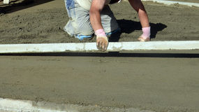 Smooth concreting the  floor Royalty Free Stock Images