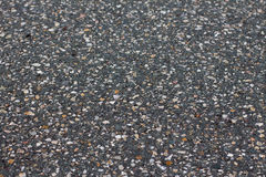 A smooth dark grey asphalt pavement texture Stock Image