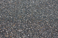 A smooth dark grey asphalt pavement texture Stock Photo