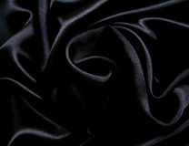 Smooth elegant black silk as background Stock Images