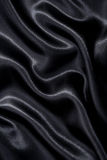 Smooth elegant black silk or satin texture as background Stock Photography