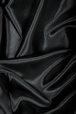 Smooth elegant black silk or satin texture as background Royalty Free Stock Images