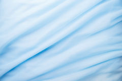 Smooth elegant blue fabric Royalty Free Stock Images