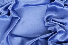 Smooth elegant blue silk Stock Photos