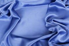 Smooth elegant blue silk Stock Photos