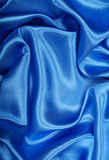 Smooth elegant blue silk as background Royalty Free Stock Images