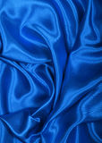 Smooth elegant blue silk as background Stock Photos