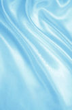 Smooth elegant blue silk or satin as background Royalty Free Stock Images