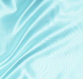 Smooth elegant blue silk or satin as background Royalty Free Stock Photos