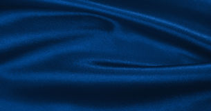 Smooth elegant blue silk or satin luxury cloth texture as abstract background. Luxurious Christmas background or New Year stock image