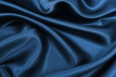 Smooth elegant blue silk or satin luxury cloth texture as abstract background. Luxurious background design. Smooth elegant blue silk or satin luxury cloth royalty free stock photo