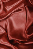 Smooth elegant brown chocolate silk or satin texture as backgrou Royalty Free Stock Image