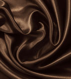 Smooth elegant brown silk or satin as background. In Sepia toned Royalty Free Stock Images