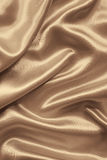 Smooth elegant brown silk or satin as background. In Sepia toned Royalty Free Stock Photography