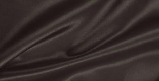 Smooth elegant brown silk or satin texture as abstract backgroun Stock Photos