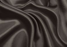 Smooth elegant brown silk or satin texture as abstract backgroun Stock Image