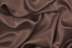 Smooth elegant brown silk or satin texture as abstract backgroun Royalty Free Stock Image