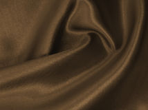 Smooth elegant brown silk or satin texture as abstract backgroun Royalty Free Stock Photography