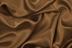 Smooth elegant brown silk or satin texture as abstract backgroun Royalty Free Stock Images