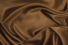 Smooth elegant brown silk or satin texture as abstract backgroun Royalty Free Stock Photo
