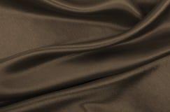 Smooth elegant brown silk or satin texture as abstract backgroun. Smooth elegant brown silk or satin texture can use as abstract background. Luxurious background Stock Photo