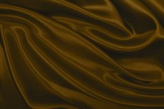 Smooth elegant brown silk or satin texture as abstract background. Luxurious background design. In Sepia toned. Retro style. Smooth elegant brown silk or satin royalty free stock photos