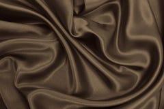 Smooth elegant brown silk or satin texture as abstract backgroun Stock Photo