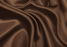 Smooth elegant brown silk or satin texture as abstract backgroun Stock Images