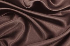 Smooth elegant brown silk or satin texture as abstract background. Luxurious background design wallpaper. In Sepia toned. Retro. Smooth elegant brown silk or stock photo