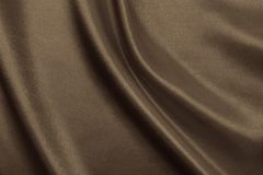 Smooth elegant brown silk or satin texture as abstract backgroun Stock Photography
