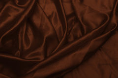 Smooth elegant brown silk or satin texture can use as abstract background. Luxurious background design wallpaper. In Stock Image