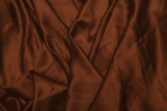Smooth elegant brown silk or satin texture can use as abstract background. Luxurious background design wallpaper. In Royalty Free Stock Images