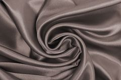 Smooth elegant brown silk or satin texture as abstract backgroun Stock Photo