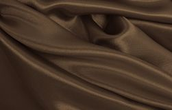 Smooth elegant brown silk or satin texture as abstract backgroun. Smooth elegant brown silk or satin texture can use as abstract background. Luxurious background Royalty Free Stock Photography