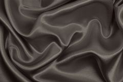 Smooth elegant brown silk or satin texture as abstract backgroun. Smooth elegant brown silk or satin texture can use as abstract background. Luxurious background Royalty Free Stock Photos