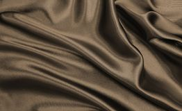 Smooth elegant brown silk or satin texture as abstract backgroun. Smooth elegant brown silk or satin texture can use as abstract background. Luxurious background Stock Images