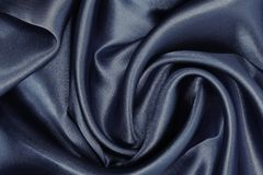 Smooth elegant brown silk or satin texture as abstract backgroun. Smooth elegant brown silk or satin texture can use as abstract background. Luxurious background Royalty Free Stock Photo