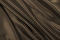 Smooth elegant brown silk or satin texture as abstract backgroun. Smooth elegant brown silk or satin texture can use as abstract background. Luxurious background Royalty Free Stock Images