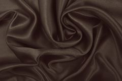 Smooth elegant brown silk or satin texture as abstract background. Luxurious background design. In Sepia toned. Retro style. Smooth elegant brown silk or satin royalty free stock images