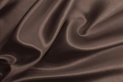 Smooth elegant brown silk or satin texture as abstract backgroun Royalty Free Stock Photos