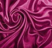 Smooth elegant burgundy silk or satin texture as background Stock Image