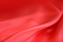 Smooth elegant crimson silk can use as background. Space for text Stock Photos