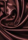 Smooth elegant dark brown chocolate silk as background Royalty Free Stock Photography