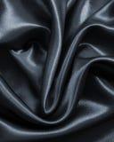 Smooth elegant dark grey silk or satin as background Royalty Free Stock Image