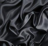 Smooth elegant dark grey silk or satin as background Stock Photography