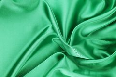 Smooth elegant emerald silk. Stock Photos