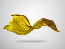 Smooth elegant gold cloth on gray background Royalty Free Stock Image
