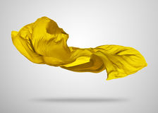 Smooth elegant gold cloth on gray background Royalty Free Stock Photos